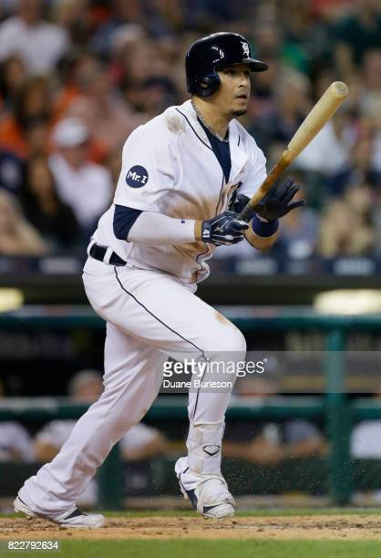 Victor Martinez of the Detroit Tigers hits a line drive to left field for an out against the Kansas City Royals during the eighth inning at Comerica...