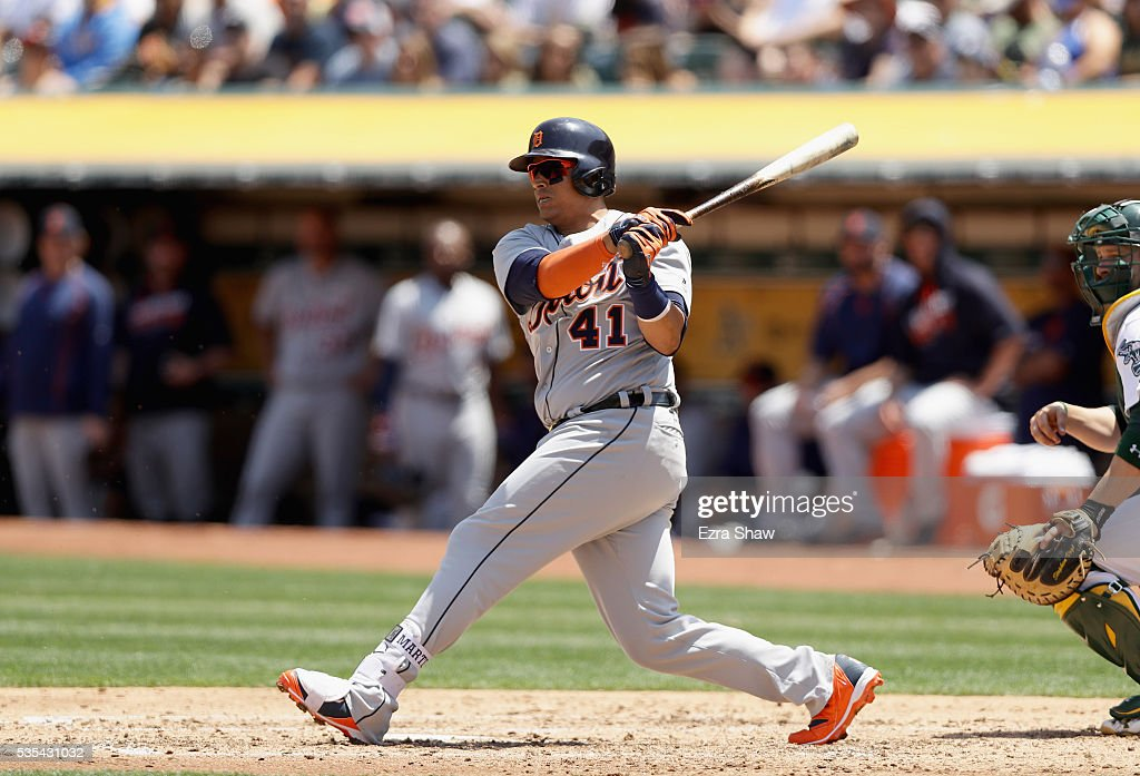 <a gi-track='captionPersonalityLinkClicked' href=/galleries/search?phrase=Victor+Martinez&family=editorial&specificpeople=210515 ng-click='$event.stopPropagation()'>Victor Martinez</a> #41 of the Detroit Tigers hits a single that scored Ian Kinsler #3 in the third inning against the Oakland Athletics at the Coliseum on May 29, 2016 in Oakland, California.