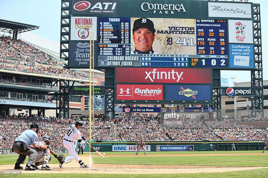 Victor Martinez #41 of the Detroit Tigers hits a three run home run to left field scoring Miguel Cabrera #24 and Ian Kinsler #3 during the third inning of the game against the Colorado Rockies at Comerica Park on August 3, 2014 in Detroit, Michigan.