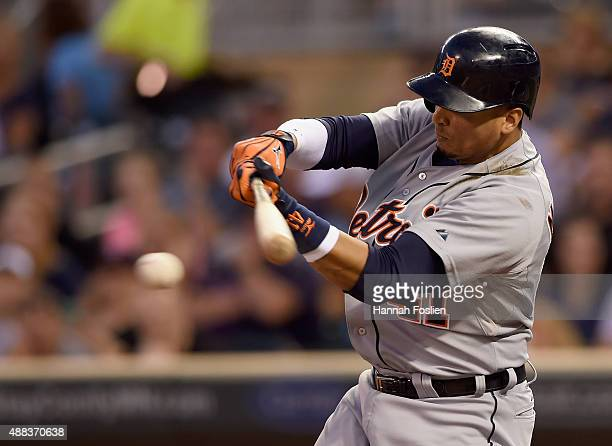Victor Martinez of the Detroit Tigers hits an RBI single against the Minnesota Twins during the first inning of the game on September 15 2015 at...