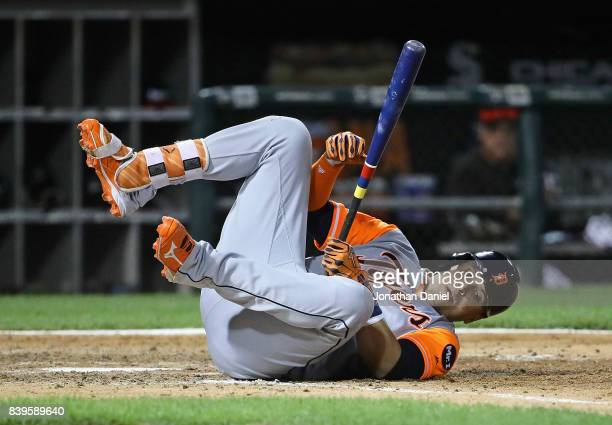 Victor Martinez of the Detroit Tigers hits the ground after ducking away from an inside pitch against the Chicago White Sox at Guaranteed Rate Field...