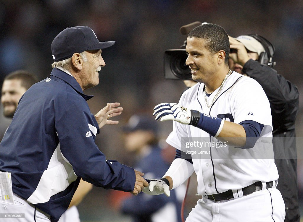 Victor Martinez #41 of the Detroit Tigers is congratulated by manager Jim Leyland #10 after his single against the Baltimore Orioles provided a 4-3 victory in the eleventh inning at Comerica Park on September 23, 2011 in Detroit, Michigan.