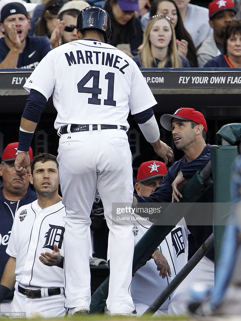 Victor Martinez #41 of the Detroit Tigers is congratulated by manager <a gi-track='captionPersonalityLinkClicked' href=/galleries/search?phrase=Brad+Ausmus&family=editorial&specificpeople=209430 ng-click='$event.stopPropagation()'>Brad Ausmus</a> #7 of the Detroit Tigers after scoring against the Tampa Bay Rays on a ground-out by Torri Hunter during the fourth inning at Comerica Park on July 4, 2014 in Detroit, Michigan.