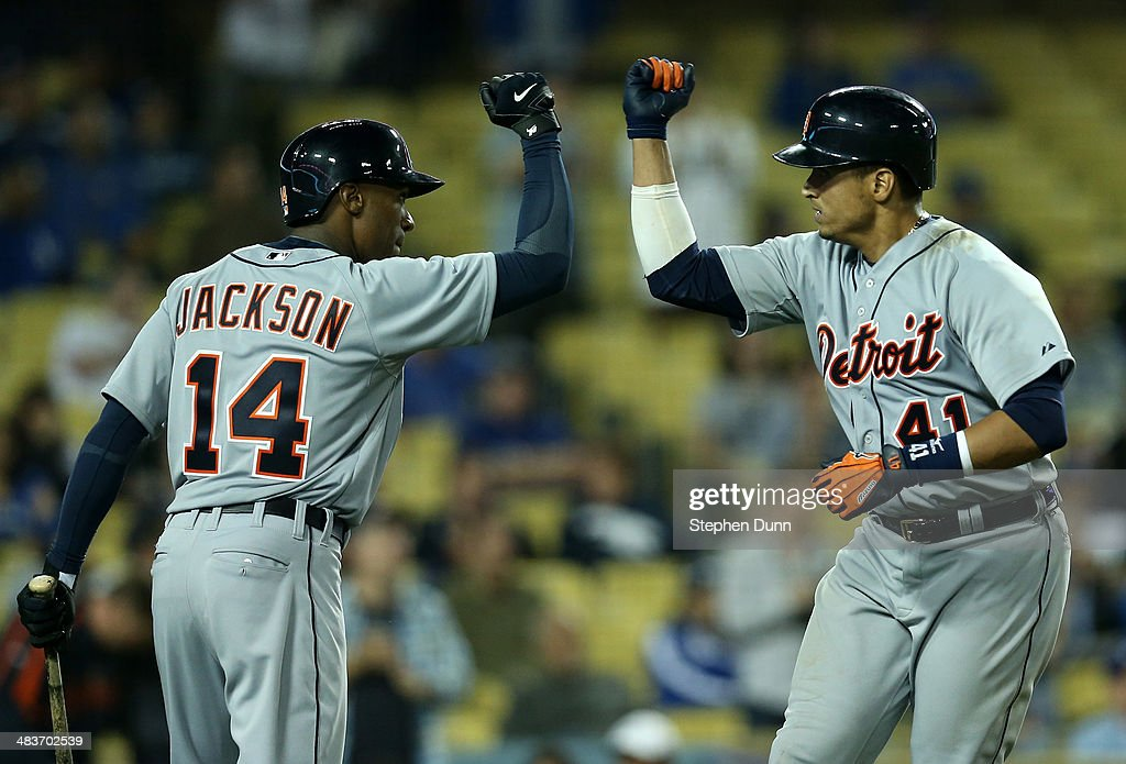Victor Martinez #41 of the Detroit Tigers is greeted by <a gi-track='captionPersonalityLinkClicked' href=/galleries/search?phrase=Austin+Jackson&family=editorial&specificpeople=608633 ng-click='$event.stopPropagation()'>Austin Jackson</a> #14 after Martinez' leadoff home run in the tenth inning against the Los Angeles Dodgers at Dodger Stadium on April 9, 2014 in Los Angeles, California.