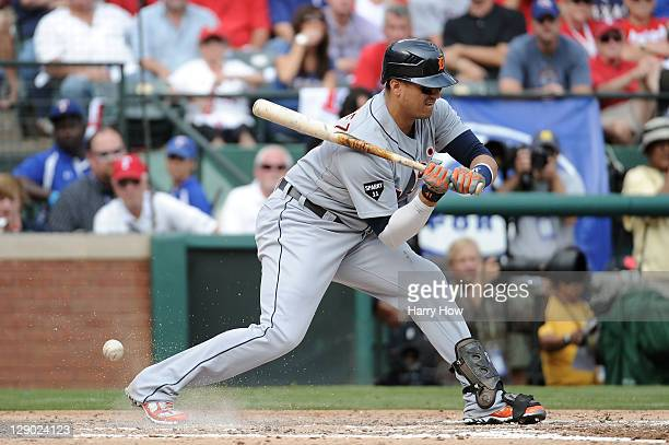 Victor Martinez of the Detroit Tigers is hit by a pitch from Derek Holland of the Texas Rangers in the third inning of Game Two of the American...