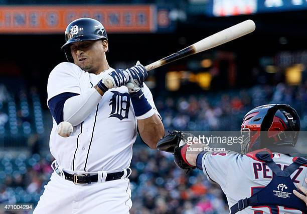 Victor Martinez of the Detroit Tigers is hit by a pitch from Cleveland Indians Danny Salazar as Roberto Perez of the Cleveland Indians works behind...