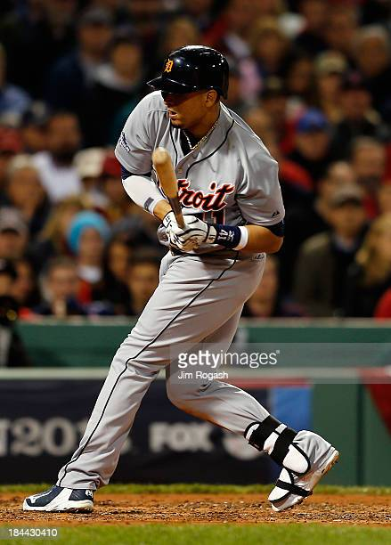 Victor Martinez of the Detroit Tigers is hit by a pitch in the fourth inning against the Boston Red Sox during Game Two of the American League...