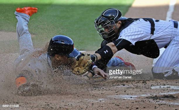 Victor Martinez of the Detroit Tigers is tagged out at the plate by Kevan Smith of the Chicago White Sox in the 2nd inning in game two at Guaranteed...