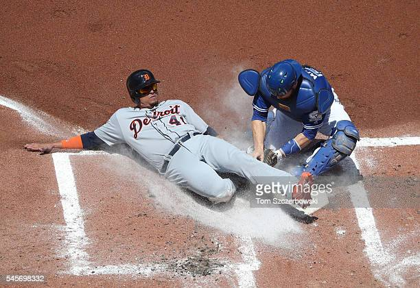 Victor Martinez of the Detroit Tigers is thrown out at home plate in the second inning during MLB game action as Russell Martin of the Toronto Blue...