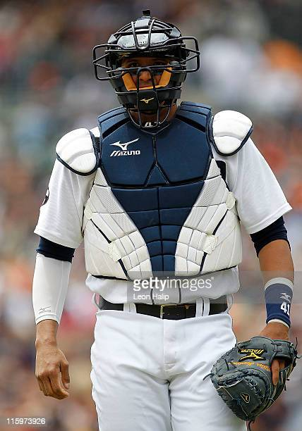 Victor Martinez of the Detroit Tigers looks into the dugout during the game against the Seattle Mariners at Comerica Park on June 12 2011 in Detroit...