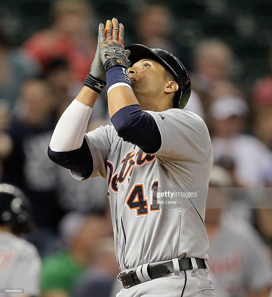 Victor Martinez #41 of the Detroit Tigers motions upward as he crossess home plate after hitting a home run in the ninth inning against the Houston Astros at Minute Maid Park on May 4, 2013 in Houston, Texas.