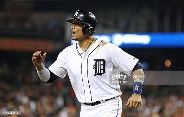 Victor Martinez of the Detroit Tigers pumps his fist after teammate JD Martinez hits a two run home run in the eight inning to tie the interleague...