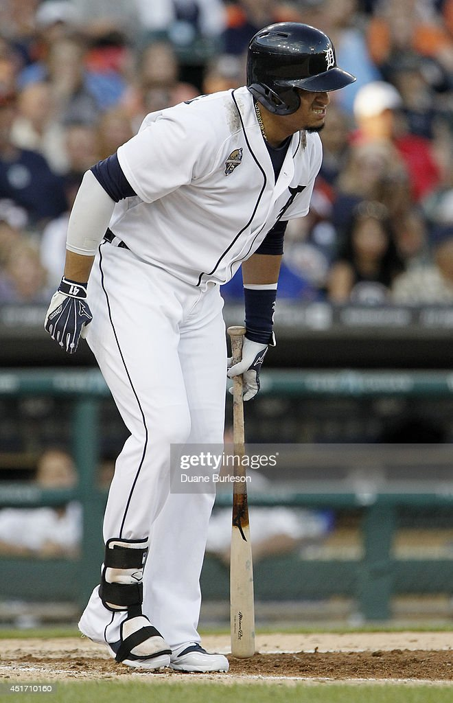 Victor Martinez #41 of the Detroit Tigers reacts after being hit on the right leg with a pitch during the fourth inning of a game against the Tampa Bay Rays at Comerica Park on July 4, 2014 in Detroit, Michigan.