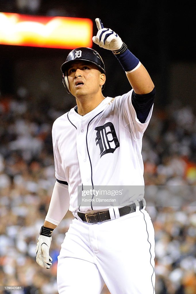 Victor Martinez #41 of the Detroit Tigers reacts hitting a solo home run in the fourth inning of Game Three of the American League Championship Series against the Texas Rangers at Comerica Park on October 11, 2011 in Detroit, Michigan.