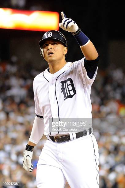 Victor Martinez of the Detroit Tigers reacts hitting a solo home run in the fourth inning of Game Three of the American League Championship Series...
