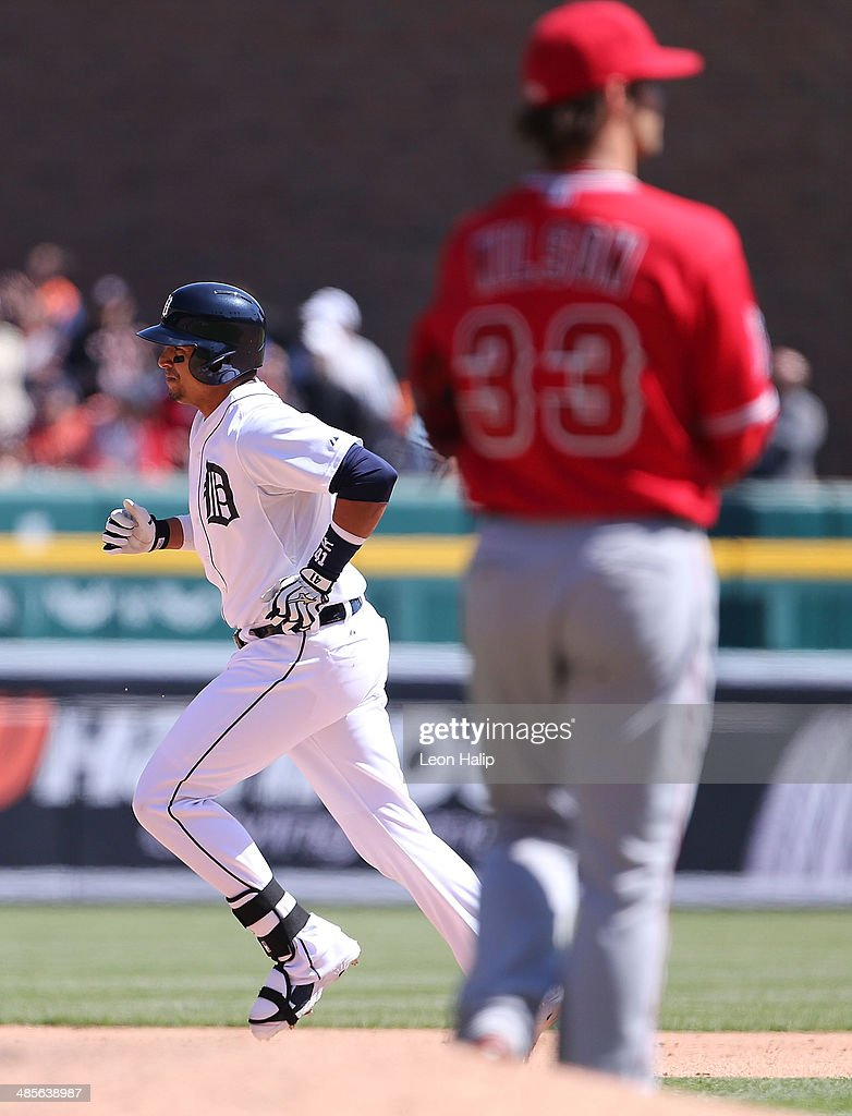 Victor Martinez #41 of the Detroit Tigers rounds second base after hitting a solo home run in the fifth inning of the game against the Los Angeles Angels of Anaheim at Comerica Park on April 19, 2014 in Detroit, Michigan.