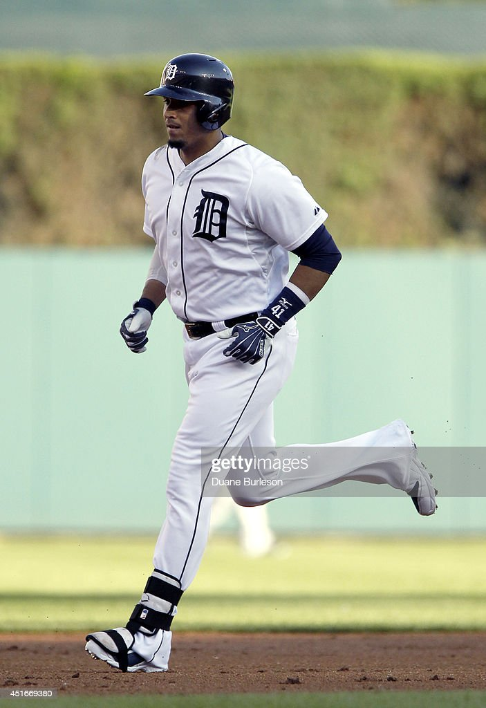 Victor Martinez #41 of the Detroit Tigers rounds the bases after hitting a two-run home run against the Tampa Bay Rays during the first inning at Comerica Park on July 3, 2014 in Detroit, Michigan. The Tigers defeated the Rays 8-1.