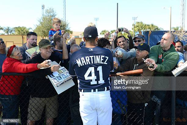 Victor Martinez of the Detroit Tigers signs autographs for fans during the spring training workout day at the TigerTown Complex on February 14 2014...