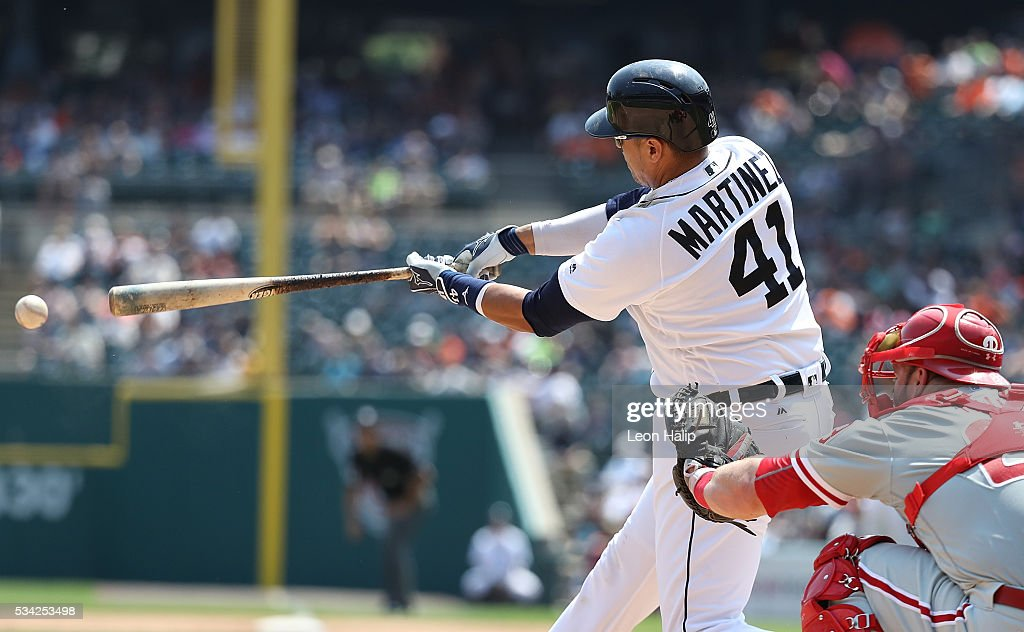 <a gi-track='captionPersonalityLinkClicked' href=/galleries/search?phrase=Victor+Martinez&family=editorial&specificpeople=210515 ng-click='$event.stopPropagation()'>Victor Martinez</a> #41 of the Detroit Tigers singles during the inter-league game against the Philadelphia Phillies on May 25, 2016 at Comerica Park in Detroit, Michigan.