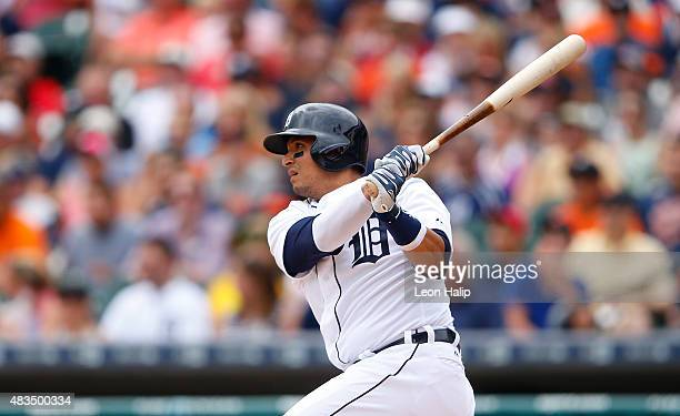 Victor Martinez of the Detroit Tigers singles to left field scoring Rajai Davis of the Detroit Tigers during the third inning of the game against the...