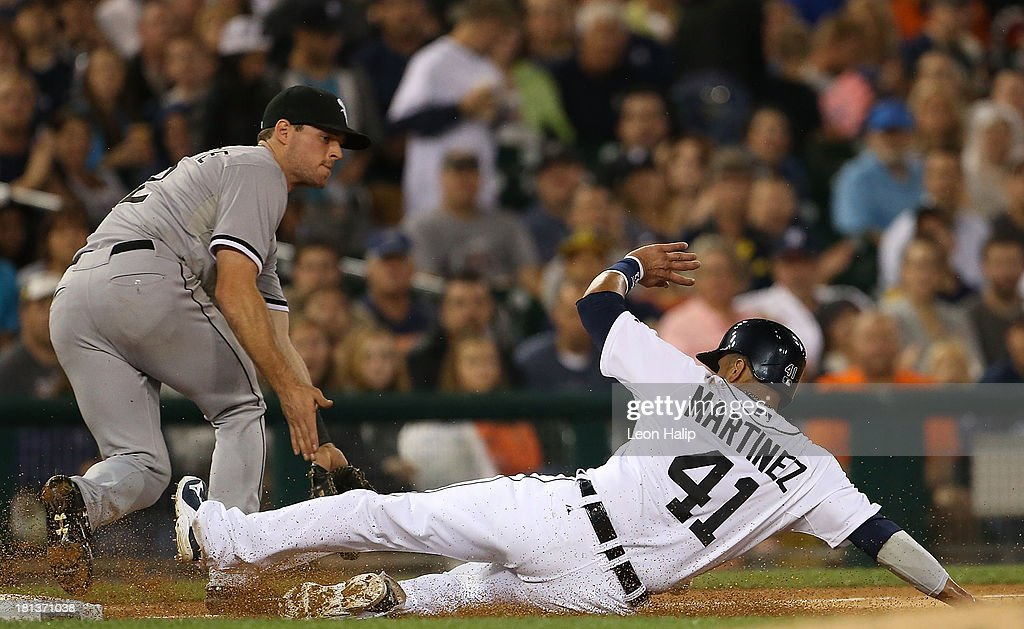 Victor Martinez #41 of the Detroit Tigers slides into third base as <a gi-track='captionPersonalityLinkClicked' href=/galleries/search?phrase=Conor+Gillaspie&family=editorial&specificpeople=5115369 ng-click='$event.stopPropagation()'>Conor Gillaspie</a> #12 of the Chicago White Sox takes the throw during the third inning of the game at Comerica Park on September 20, 2013 in Detroit, Michigan.