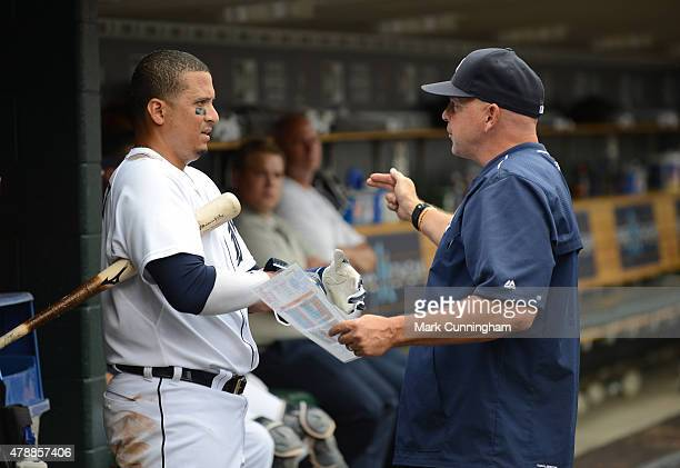 Victor Martinez of the Detroit Tigers talks with hitting coach Wally Joyner in the dugout during the game against the Chicago White Sox at Comerica...