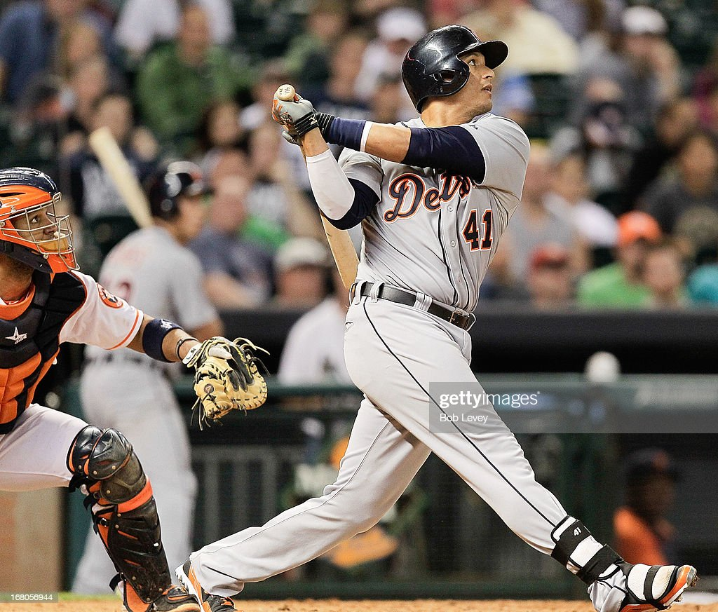 Victor Martinez #41 of the Detroit Tigers watches the ball leave the park as he hits a home run in the ninth inning against the Houston Astros at Minute Maid Park on May 4, 2013 in Houston, Texas.