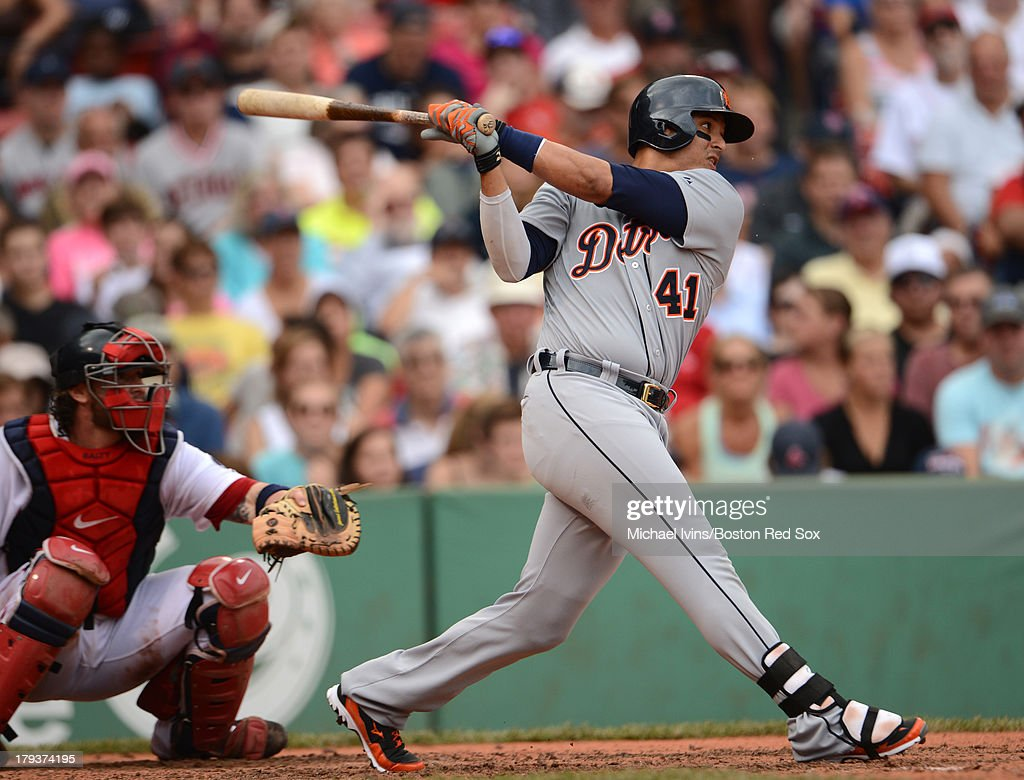 Victor Martinez #41of the Detroit Tigers hits a single against the Boston Red sox in the seventh inning on September 2, 2013 at Fenway Park in Boston Massachusetts.