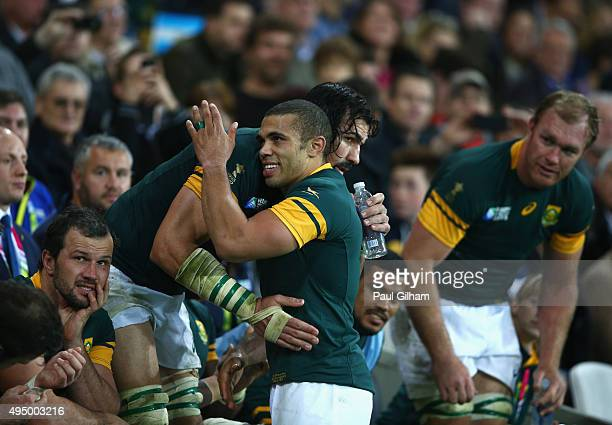 Victor Matfield of South Africa hugs Bryan Habana of South Africa as he joins him in the dugout during the 2015 Rugby World Cup Bronze Final match...