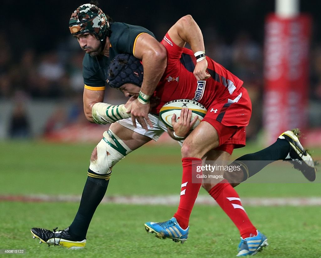 Victor Matfield (captain) of South Africa with a big tackle on Matthew Morgan of the Wales during the Incoming Tour match between South Africa and Wales at Growthpoint Kings Park on June 14, 2014 in Durban, South Africa.
