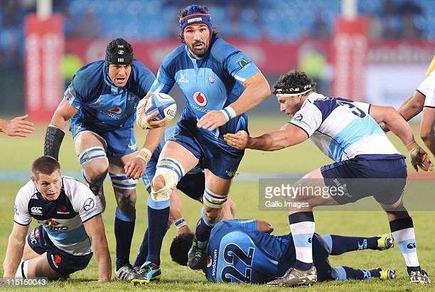 Victor Matfield of the Bulls runs with the ball during the Super Rugby match between Vodacom Bulls and Waratahs at Loftus Versfeld on June 03 2011 in...