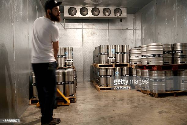 Victor Mesa a beer brewer places kegs of beer in the cooler at Wynwood Brewing Company on April 25 2014 in Miami Florida Earlier this week Floridas...