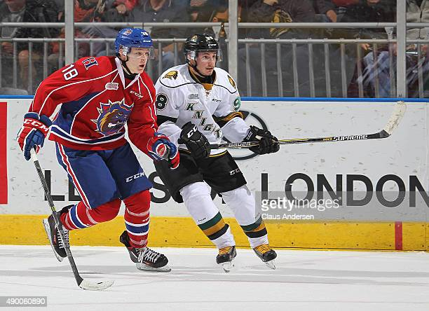 Victor Mete of the London Knights skates against Matthew Strome of the Hamilton Bulldogs in an OHL game at Budweiser Gardens on September 25 2015 in...