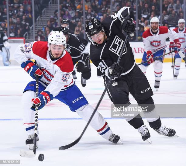 Victor Mete of the Montreal Canadiens battles for the puck against Dustin Brown of the Los Angeles Kings at STAPLES Center on October 18 2017 in Los...