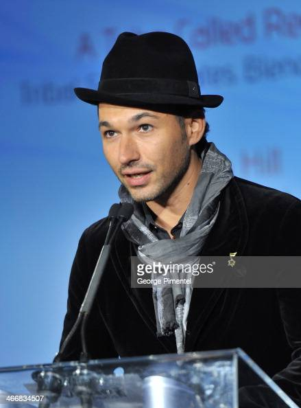 Victor Micallef of the Canadian Tenors speaks at the 2014 Juno Awards Nominee Press Conference at The Design Exchange on February 4 2014 in Toronto...