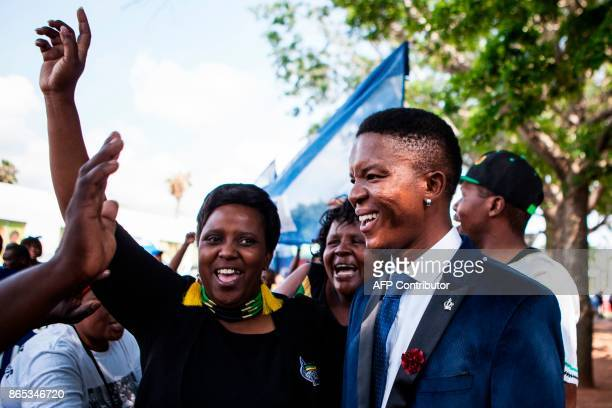 TOPSHOT Victor Mlotshwa is welcomed by supporters as he arrives at the Middleburg Court on October 23 2017 in Middlebrug South Africa A South African...