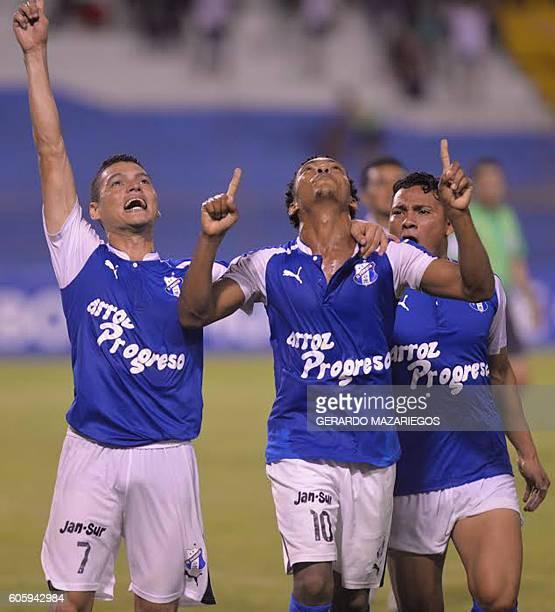 Victor Moncada Luis Alvarado and Carlos Sanchez of Honduras Progreso celebrate a goal against Pumas of Mexico during their CONCACAF Champions League...