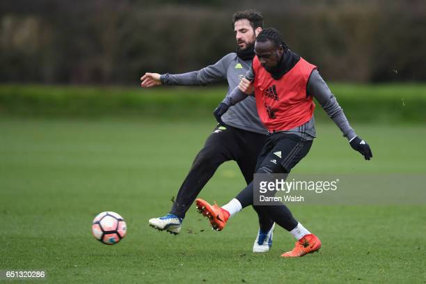 Victor Moses and Cesc Fabregas of Chelsea during a training session at Chelsea Training Ground on March 10 2017 in Cobham England