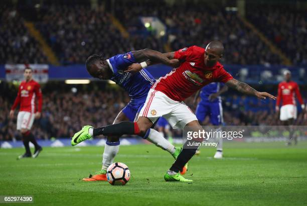 Victor Moses of Chelsea and Ashley Young of Manchester United battle for the ball during The Emirates FA Cup QuarterFinal match between Chelsea and...