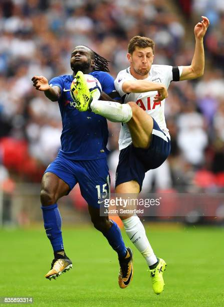Victor Moses of Chelsea and Ben Davies of Tottenham Hotspur battle for possession during the Premier League match between Tottenham Hotspur and...