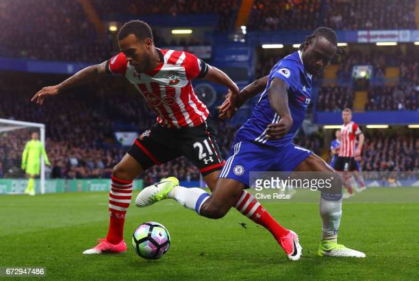 Victor Moses of Chelsea and Ryan Bertrand of Southampton battle for the ball during the Premier League match between Chelsea and Southampton at...