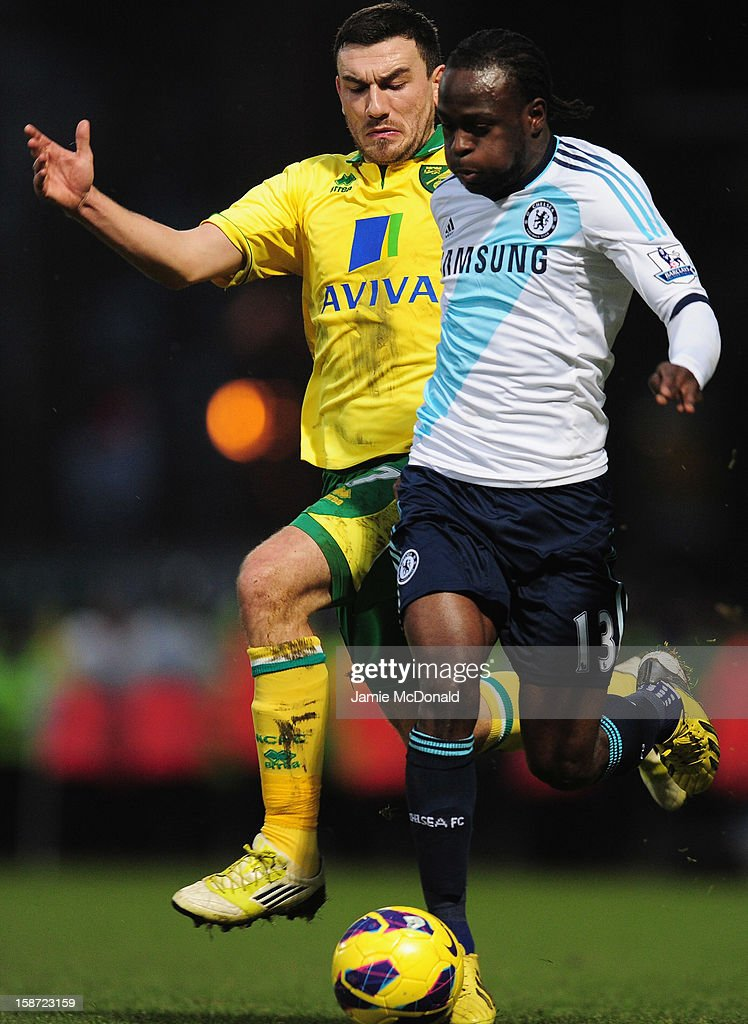 Victor Moses of Chelsea battles with Robert Snodgrass of Norwich City during the Barclays Premier League match between Norwich City and Chelsea at Carrow Road on December 26, 2012 in Norwich, England.
