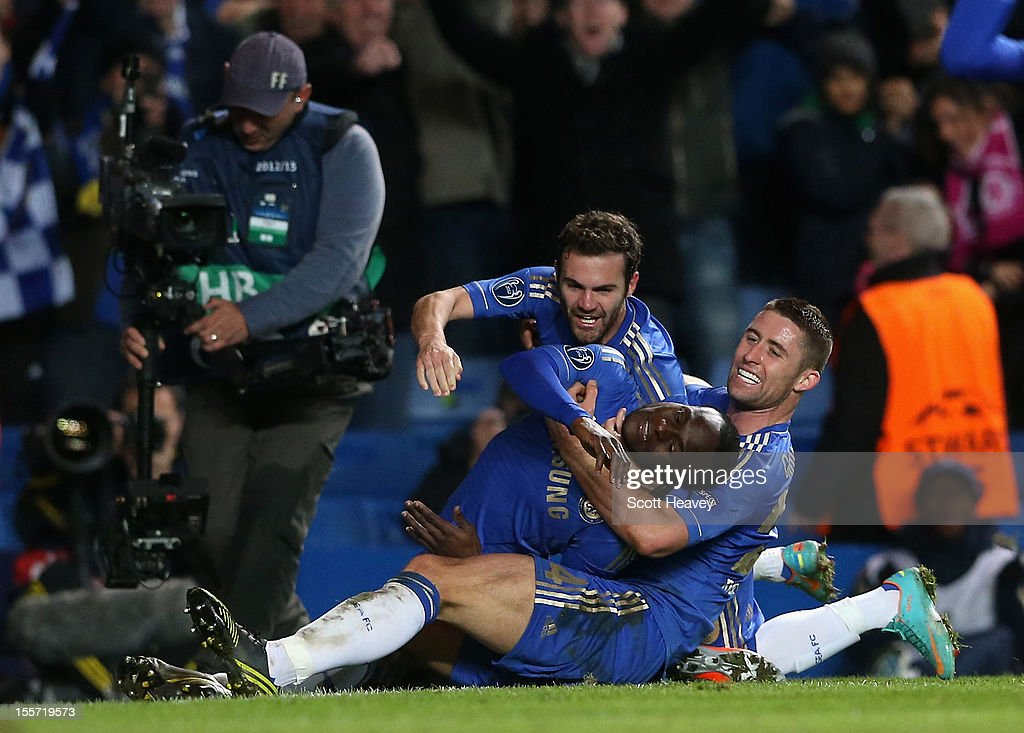 <a gi-track='captionPersonalityLinkClicked' href=/galleries/search?phrase=Victor+Moses&family=editorial&specificpeople=2649383 ng-click='$event.stopPropagation()'>Victor Moses</a> of Chelsea celebrates his goal with <a gi-track='captionPersonalityLinkClicked' href=/galleries/search?phrase=Juan+Mata&family=editorial&specificpeople=4784696 ng-click='$event.stopPropagation()'>Juan Mata</a> and <a gi-track='captionPersonalityLinkClicked' href=/galleries/search?phrase=Gary+Cahill&family=editorial&specificpeople=204341 ng-click='$event.stopPropagation()'>Gary Cahill</a> during the UEFA Champions League Group E match between Chelsea and Shakhtar Donetsk at Stamford Bridge on November 7, 2012 in London, England.