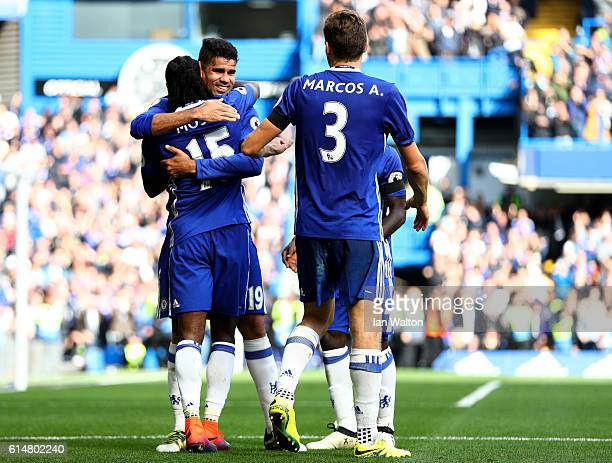 Victor Moses of Chelsea celebrates scoring his sides third goal wiith Diego Costa of Chelsea during the Premier League match between Chelsea and...