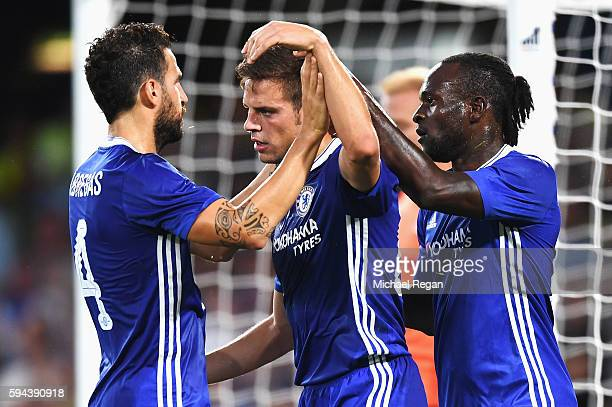 Victor Moses of Chelsea celebrates scoring his team's second goal with Cesar Azpilicueta and Cesc Fabregas during the EFL Cup second round match...
