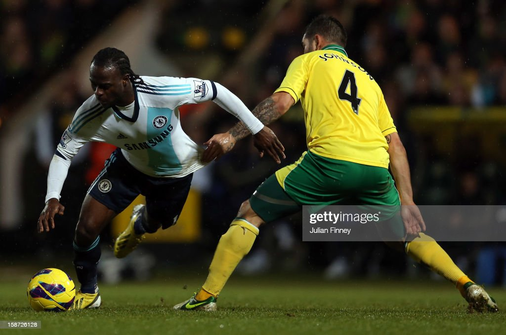 Victor Moses of Chelsea goes past Bradley Johnson of Norwich City during the Barclays Premier League match between Norwich City and Chelsea at Carrow Road on December 26, 2012 in Norwich, England.
