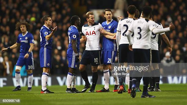 Victor Moses of Chelsea Harry Kane of Tottenham Hotspur and Nemanja Matic of Chelsea CR argue during the Premier League match between Tottenham...
