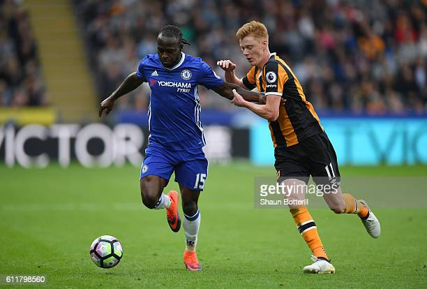 Victor Moses of Chelsea holds off the challenge of Sam Clucas of Hull during the Premier League match between Hull City and Chelsea at KCOM Stadium...