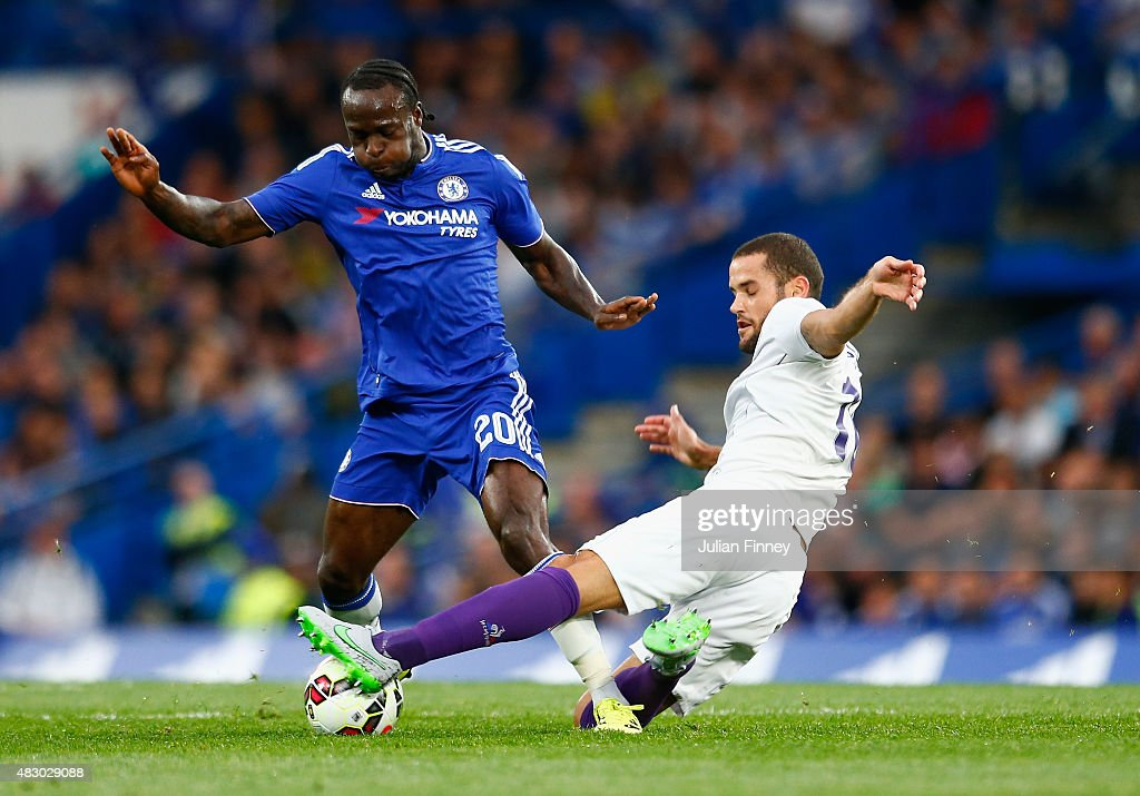 Victor Moses of Chelsea is challenged by Mario Suarez of Fiorentina during the Pre Season Friendly match between Chelsea and Fiorentina at Stamford...