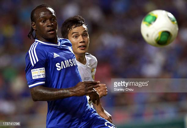 Victor Moses of Chelsea is checked by Nattaporn of Singha Thailand AllStar XI during the international friendly match between Chelsea FC and the...